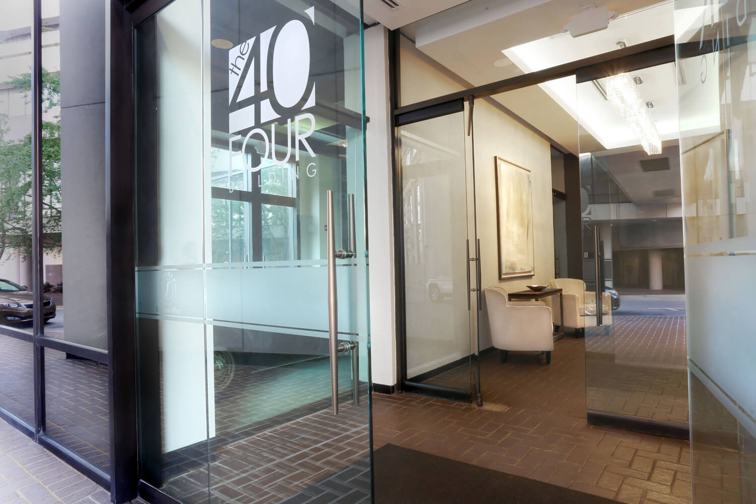 The 40 Four Building Designed by Foshee Architecture – Glass Doors at Front Entry