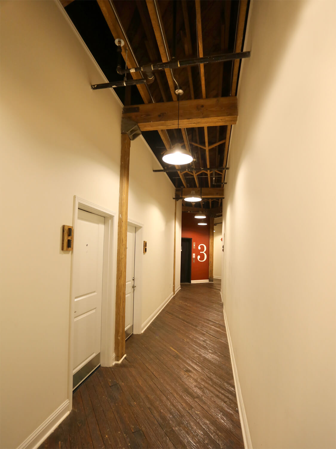 Printing Press Lofts Designed by Foshee Architecture - Apartment Corridor and Hallway