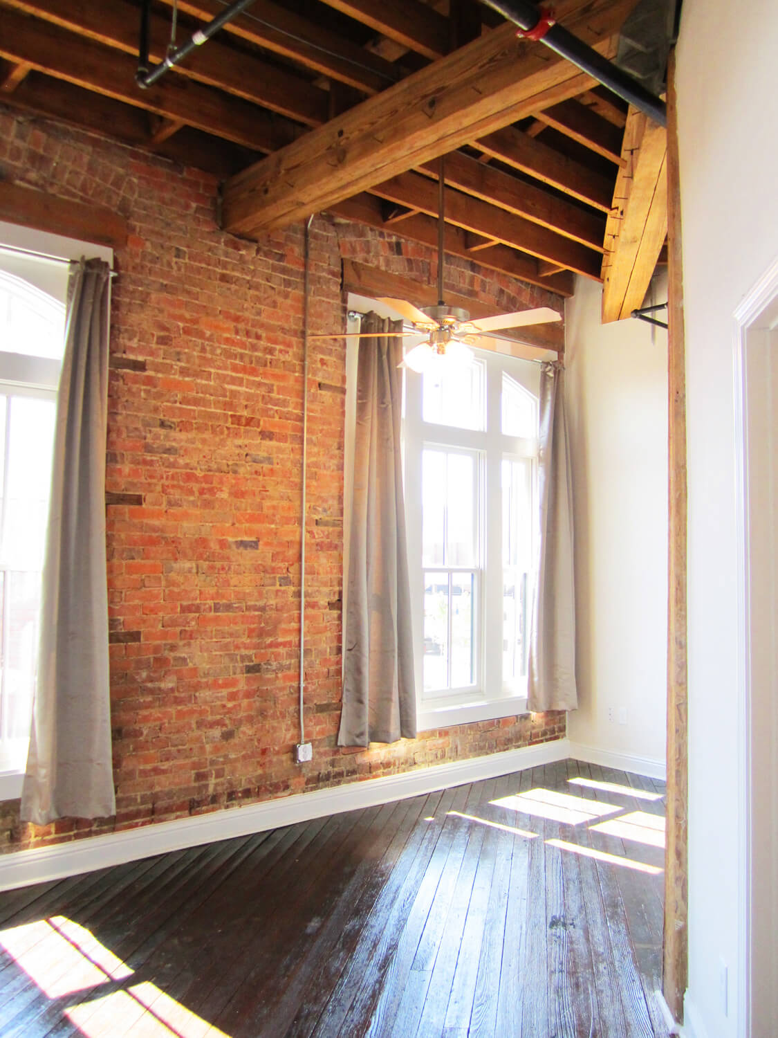 Printing Press Lofts Designed by Foshee Architecture - Apartment Bedroom with Exposed Wood Ceiling