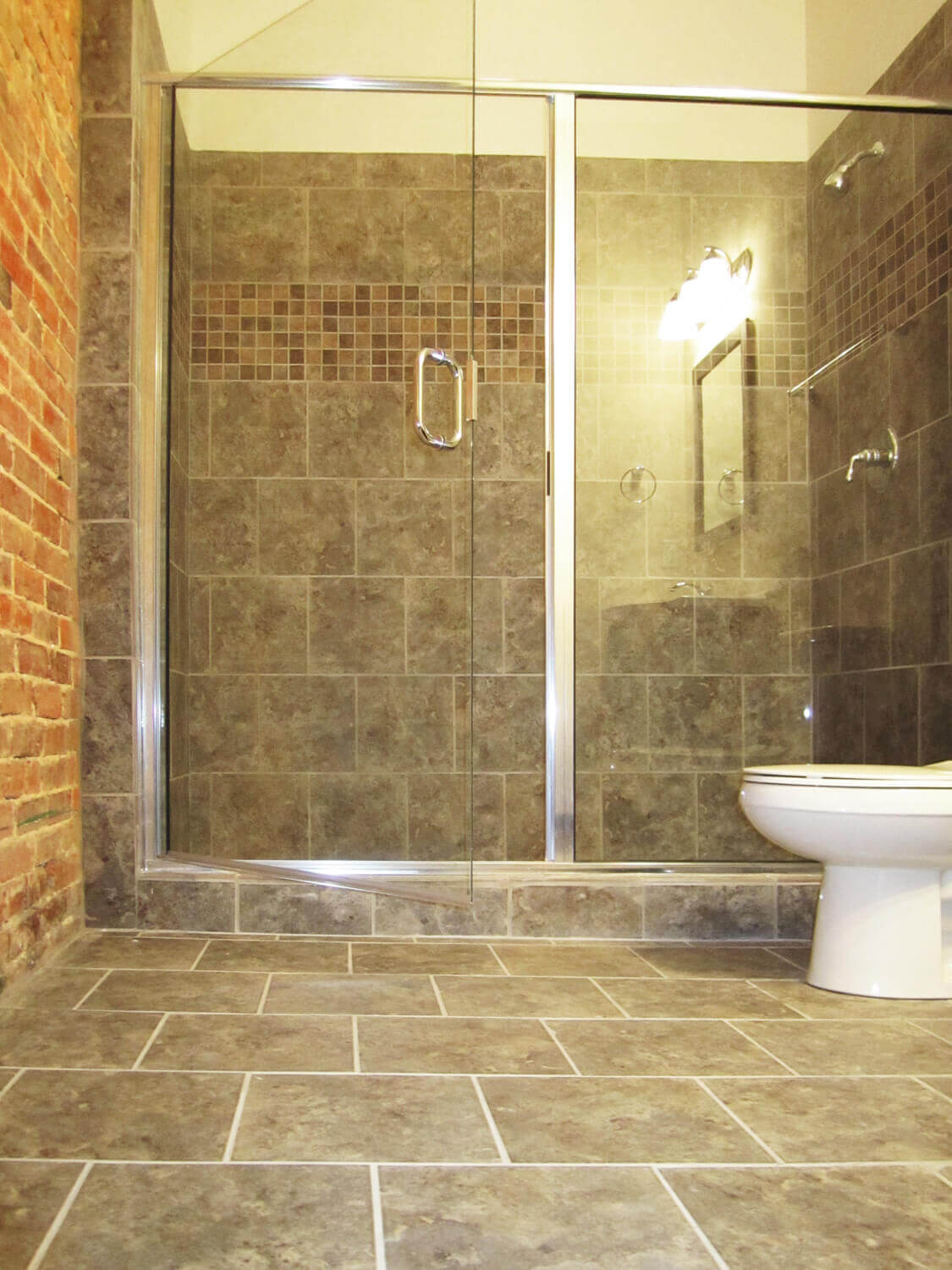Printing Press Lofts Designed by Foshee Architecture - Apartment Bathroom with a Tile Shower