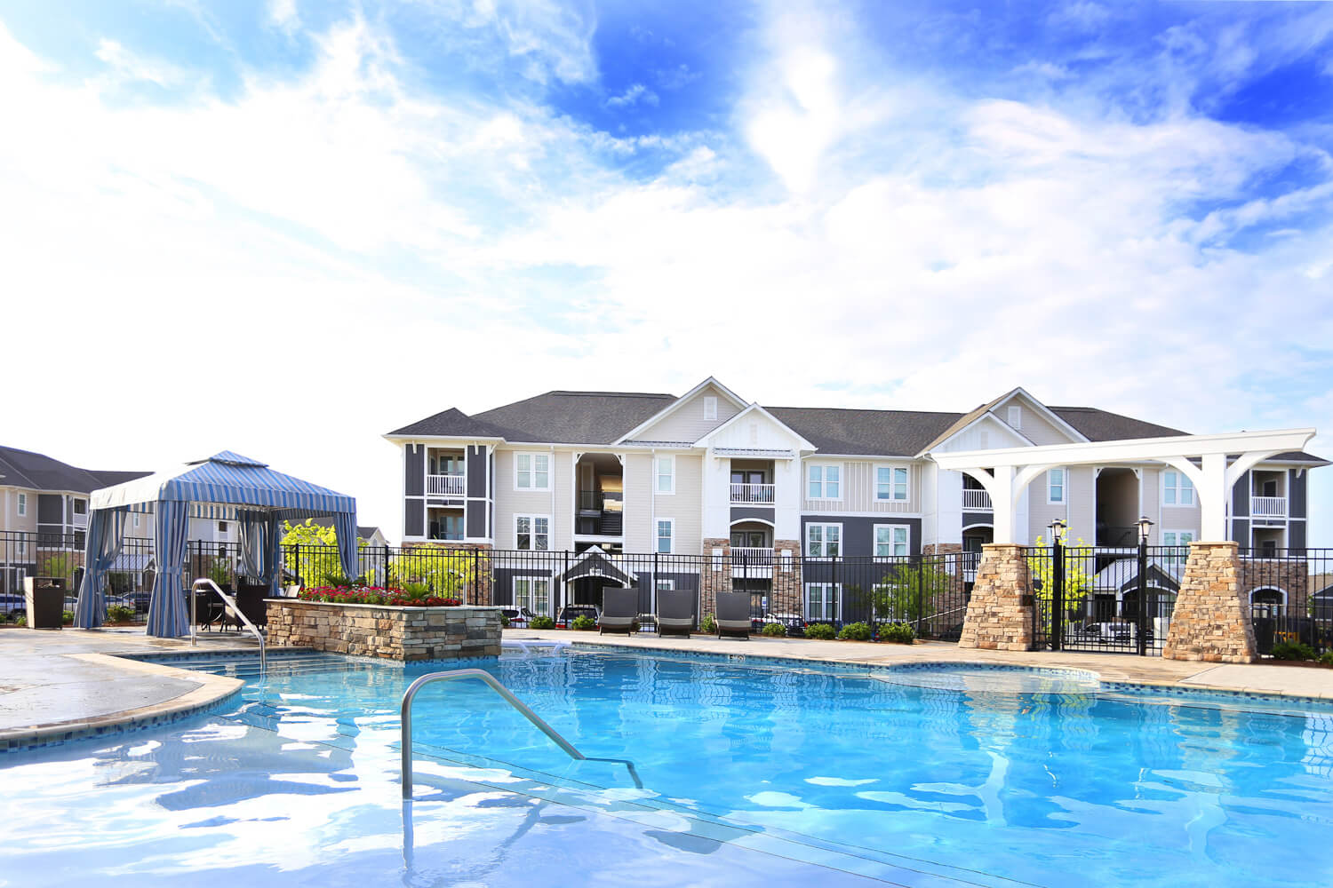 The Morgan Apartments Clubhouse Designed by Foshee Architecture - View of Pool Looking Towards the Apartment Buildings