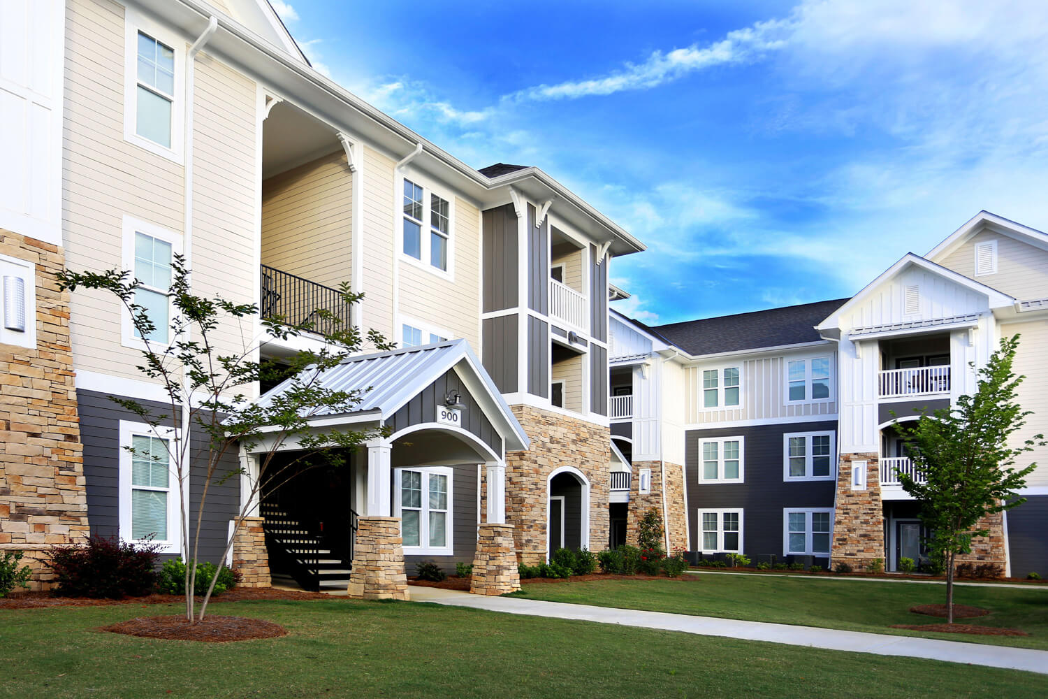 The Morgan Apartments Designed by Foshee Architecture - Exterior View of Sidewalk and Entry