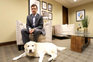 Foshee Multifamily Architecture - Homepage John Foshee Founder with Molly Dog